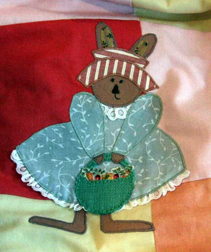 Detail from Bunny Appliqué Quilt. Fabulous bit of veggie fabric in her basket!